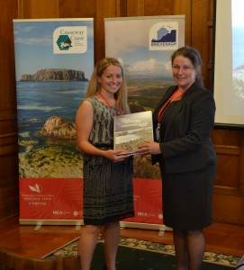 Liz Wallace, Magilligan Field Centre, presents Claire Connor, teacher from Ashfield Girl's High School, with her copy of the Field Guide.